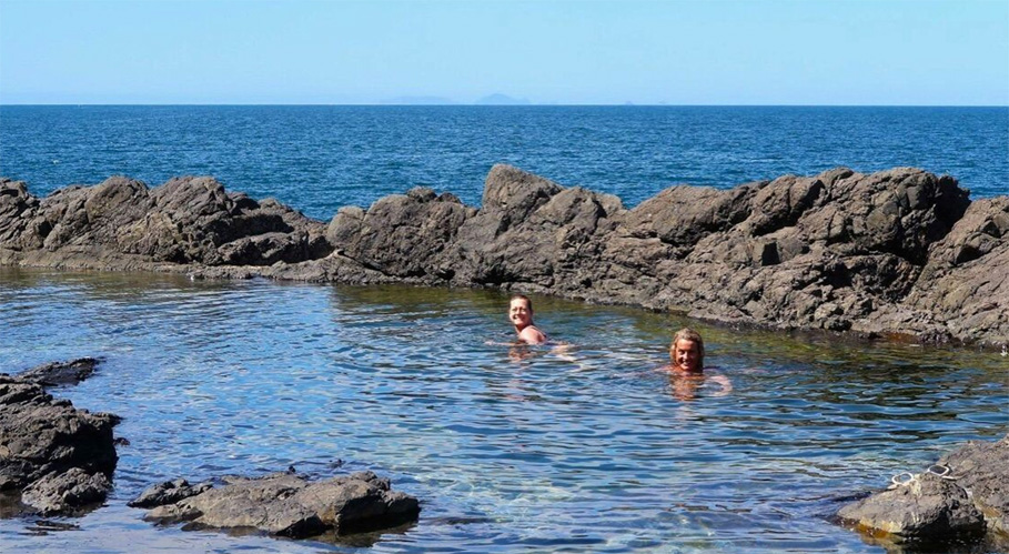 Swimmers enjoying the rock pool